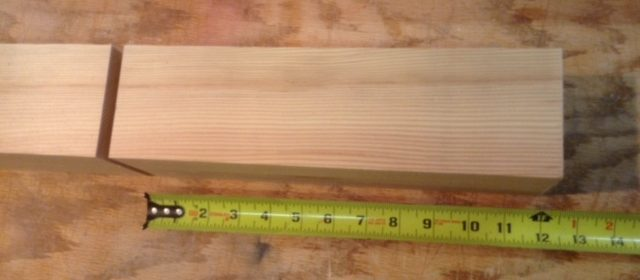 Photo of wood being measured.