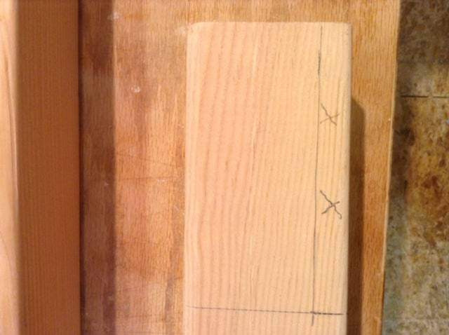 Photo of measured and marked wood.